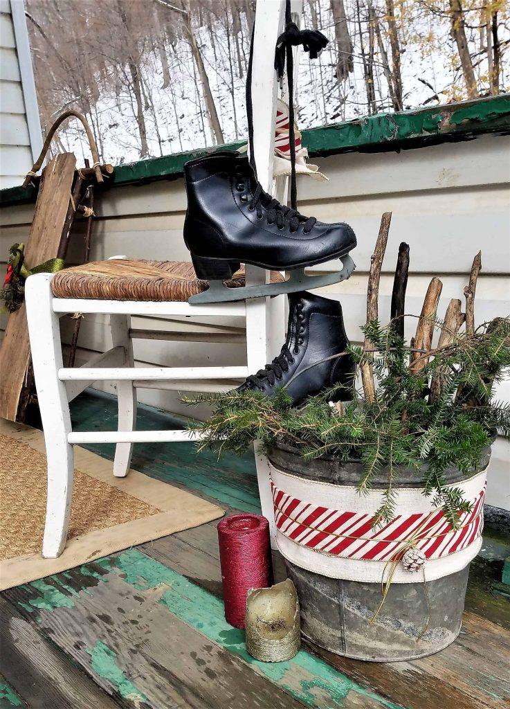 Christmas porch decor- ice skates and tin bucket